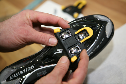look cleats being bolted | guide to cycling pedals and shoes